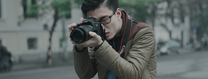 young man holding a camera