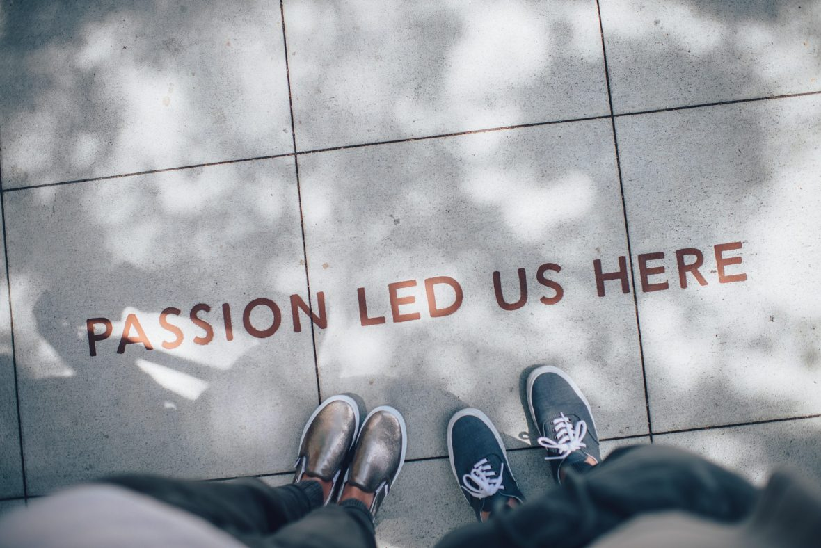 "the floor reads ""passion led us here"""