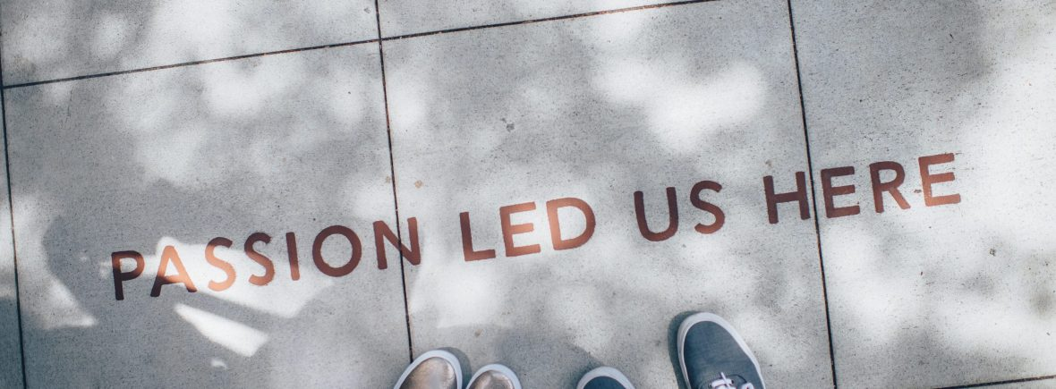 """the floor reads """"passion led us here"""""""